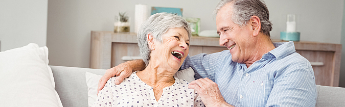 wellness65-article_senior-couple-sitting-on-sofa_171025