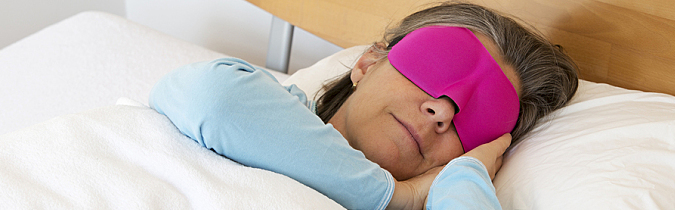 wellness65-article_woman-sleeping-with-sleep-mask_170125
