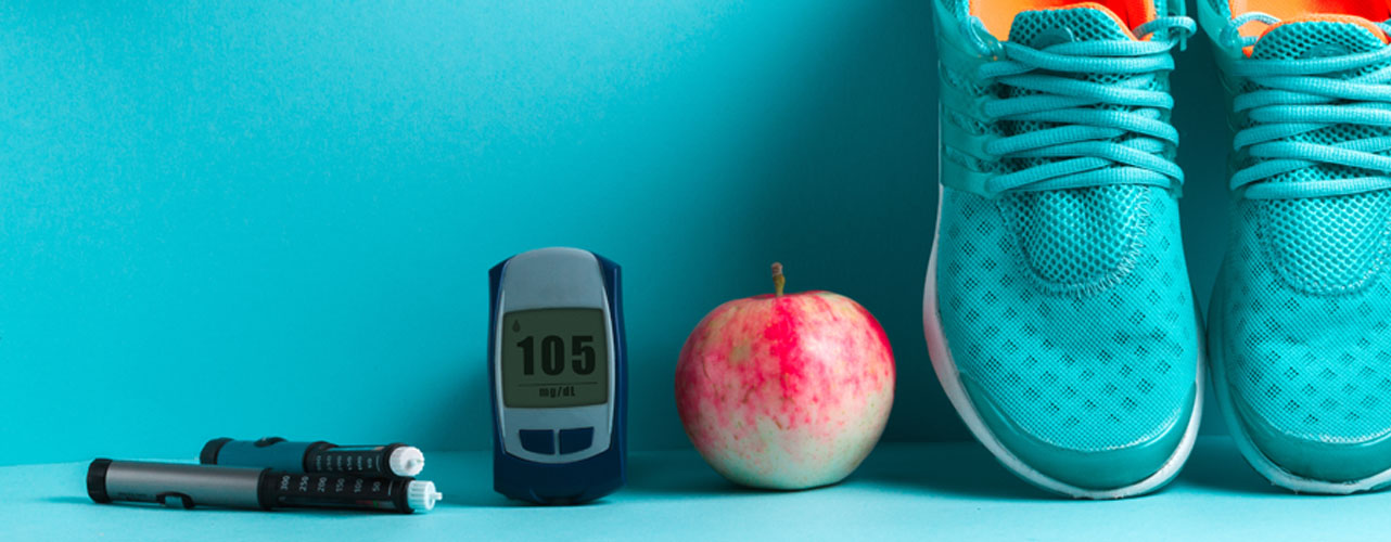diabetes-testing-supplies-and-sneakers-on-blue __desktop